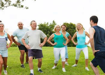 Group of elderly people are enjoying a fitness class in the park