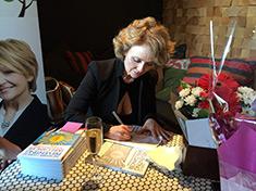 Karen signing books