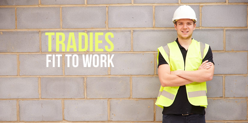 Tradies standing with his arms crossed.